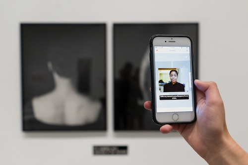 Person scanning an artwork at the Hirschhorn museum, using their mobile app Hi