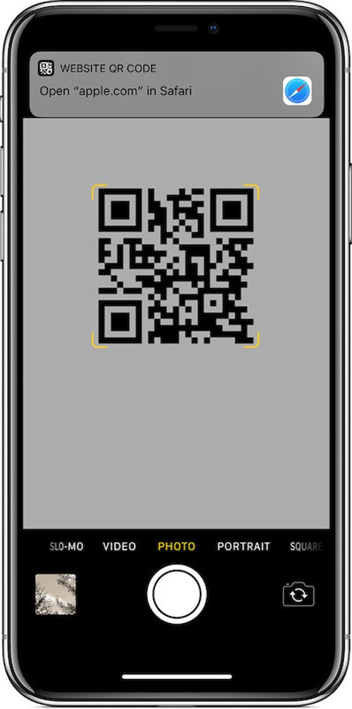 iOS detects QR codes automatically and prompts you to visit the linked website.