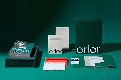 Orior set of printed materials on a table.