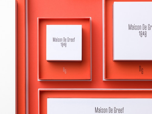 Different cardboard boxes designed for Maison de Greef  imbricated in other sizes of boxes