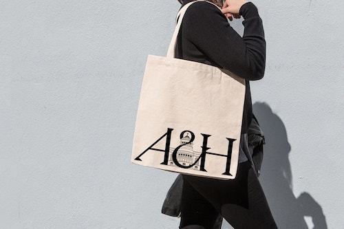 A tote bag styled with the new logo of the Art and History Museum