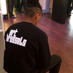 Application of the logo on a black hoodie