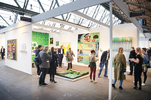 Visitors walking into an exhibition of Art Brussels Fair