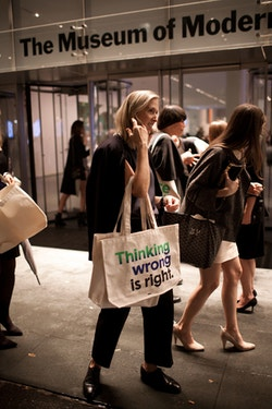 An old woman at the event with a tote bag