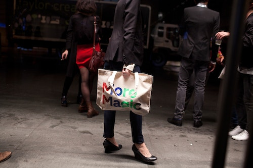 A young woman with high heels and a tote bag
