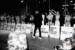 An organiser of the event getting applause by models on the stage