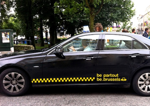 A simulation of be brussels logo on a taxi