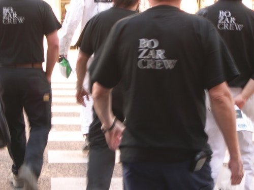 Black t-shirts branded with the new identity of Bozar