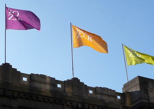 Application of the logotype designed for Bozar on coloured flags