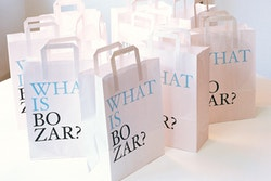 Application of Bozar visual identity on cardboard bags