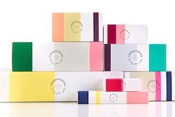 A pile of cardboard boxes for Common Bond branding packaging