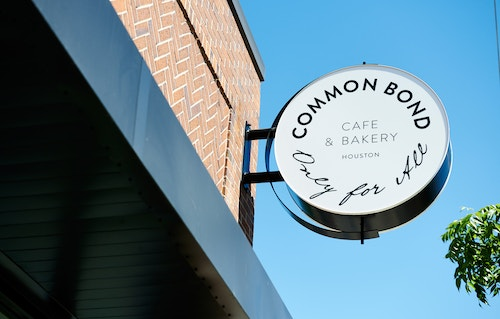 A signage for the Common Bond Cafe in Houston