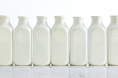 A range of white water jugs designed for Common Bond on a table