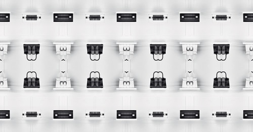 A series of black and white bags from Delvaux on a white background