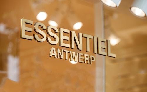 The typographic logo designed for Essentiel Antwerp on the door of the store