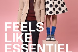 "A poster with a girl holding the head of a young man in front of a pink blackground with the quote ""Feels like Essentiel Antwerp"""