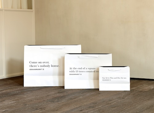 Three different sizes bags with Graanmarkt 13 identity