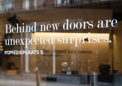 Quote on the window of Graanmarkt 13 store in Komedieplaats