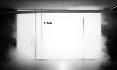 The logo of Group8 in the door of a room
