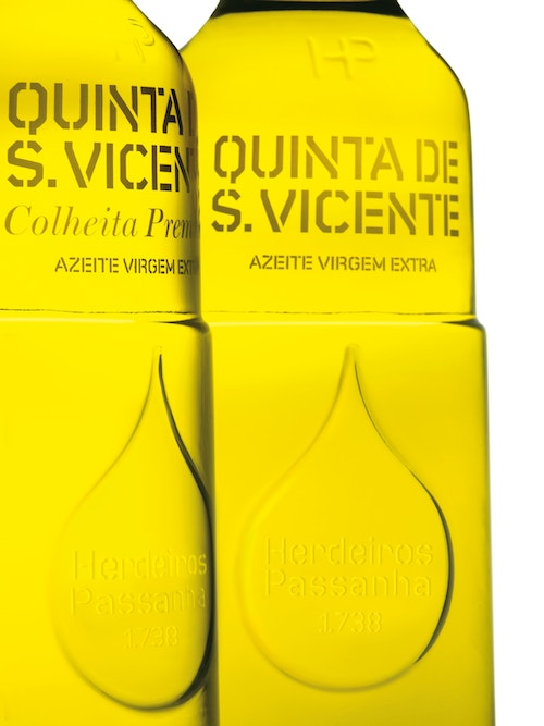 Close-up view of two bottles of olive oil from Herdeiros Passanha