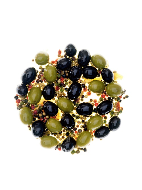 A mix of olives with a sauce