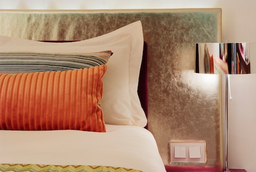 Close-up view of a cozy bed in a room of the Hotel Missoni