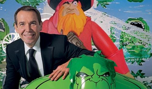Jeff Koons pausing with a Hulk mascot