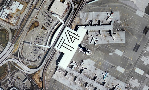 Aerian view of the logo for Jfk Terminal 4 on the roof of the infrastructure