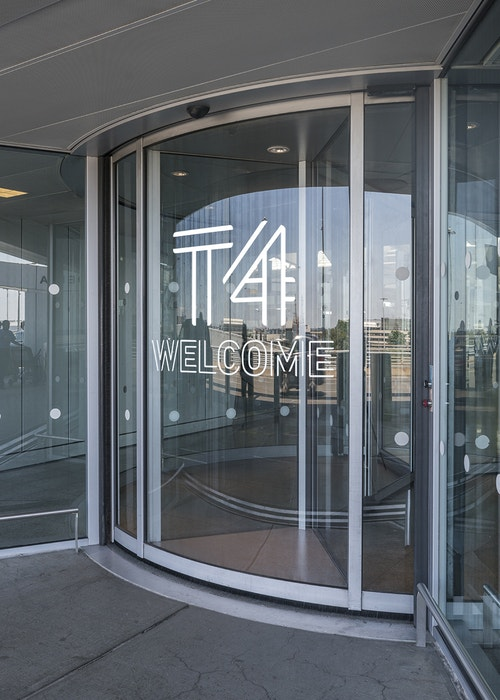 Glass door of Jfk Terminal 4 with the logo