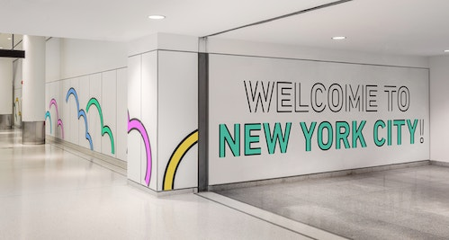 Illustration and signage in a corridor of Jfk Terminal 4