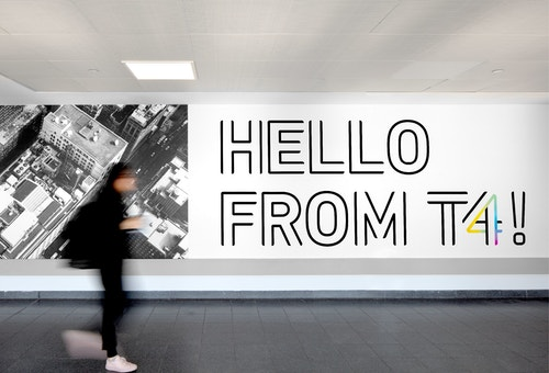 A signage in Jfk Terminal 4 welcoming passengers