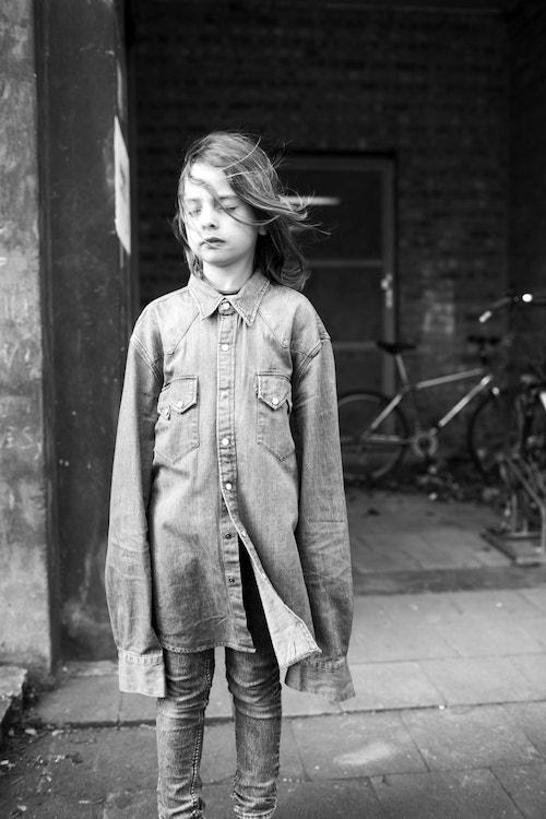 A girl wearing an oversized jacket