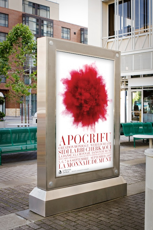 A poster designed for La Monnaie De Munt's communication on an advertising screen in a public space