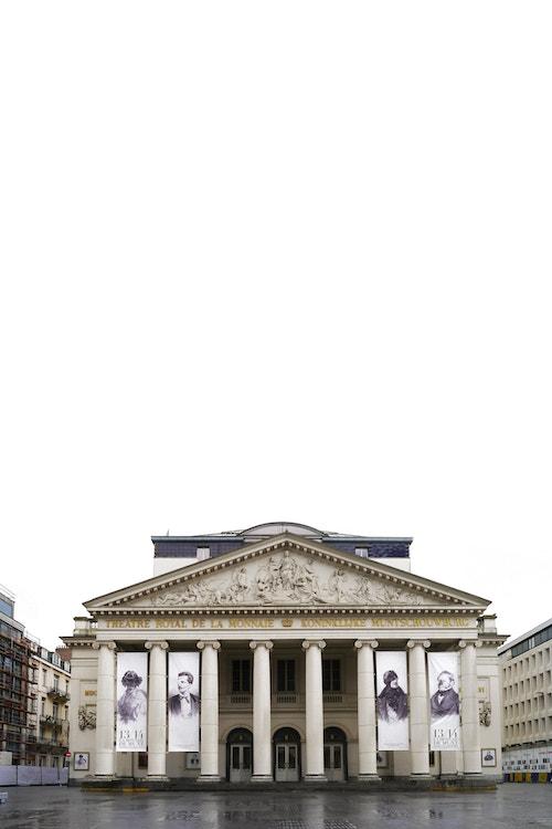 Vertical photo of the facade of Theatre de La Monnaie by day