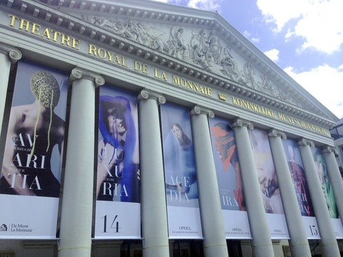 The facade of Theatre Royal de La Monnaie with kakemono posters hanging