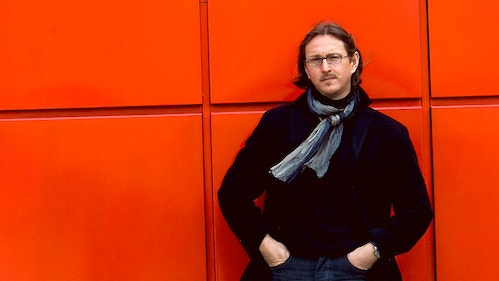 General Director Intendant Peter De Caluwe pausing in front of a red wall