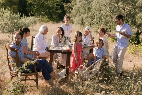 A family sharing a meal in the countryside