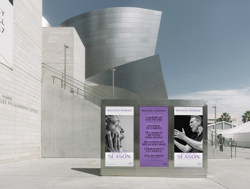 A set of posters designed for Los Angeles Master Chorale on an infrastructure next to the building of Los Angeles Master Chorale