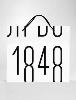 """A shopping bag branded with the """"1848"""" logo designed for Maison de Greef"""
