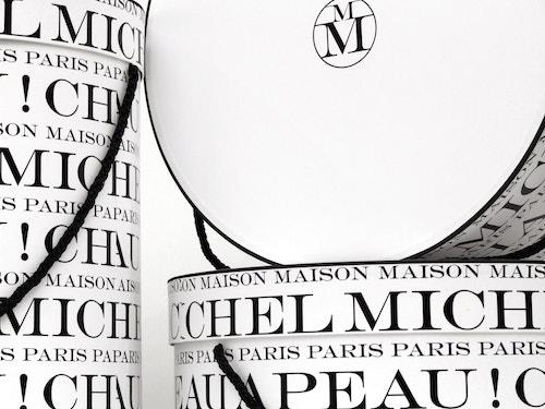 Close-up view of Maison Michel hat boxes