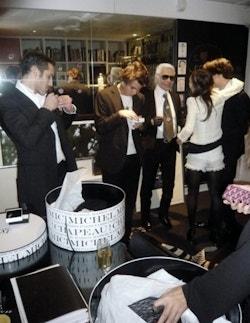 Karl Lagerfeld walking into Maison Michel in Paris