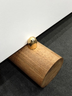 A doorstop made of wood by Maison Vervloet