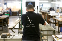 A worker of Maison Vervloet wearing a t-shirt with the logo of the brand