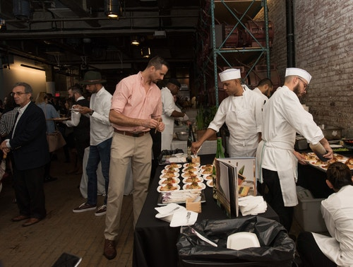 People eating food at an event organised by the Meatpacking District Association
