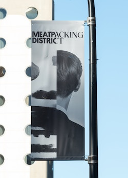 Application of a visual designed for the Meatpacking District on a roll-up banner