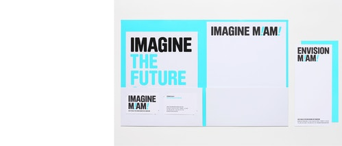 A folder and an enveloppe designed for the Miami Art Museum standing on a white table