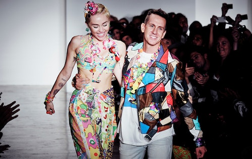 Miley Cyrus and Jeremy Scott walking side to side during the closing of the fashion show