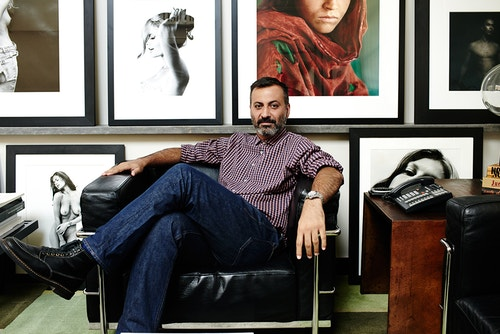 Co-founder of Milk Studios Mazdack Rassi on a chair in his office