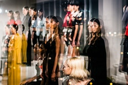 A group of models pausing with a blurry effect