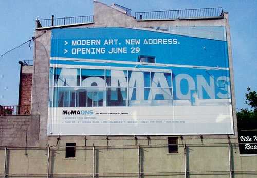 A banner designed for Moma Queens' communication campaign on a large advertising panel